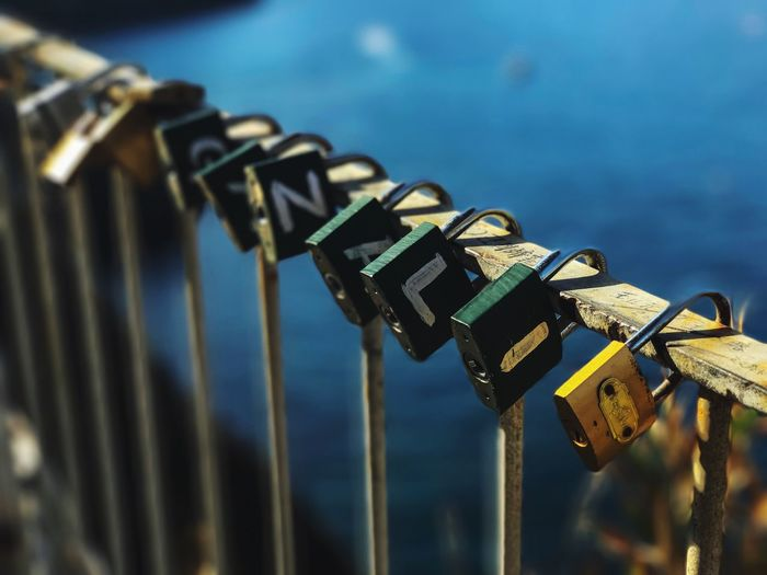 Cliff Metal Security Railing Safety Padlock No People Protection Day Lock Outdoors Water Close-up Love Lock Sky