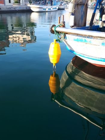 Water Nautical Vessel Reflection No People Transportation Outdoors Moored Day Harbourfront Habour Yellow Water Sea Fishing Boat Boats And Water Boat Boa