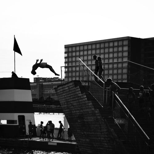 Freezing the moment Silhouette Swimming Jump Diver Diving Nordic Light Travel Photography Tourism Black And White Architecture Real People Built Structure Group Of People Sky Staircase Clear Sky Building Exterior Men Railing People Day Leisure Activity City Outdoors Women Steps And Staircases Summer Sports Summer In The City A New Beginning