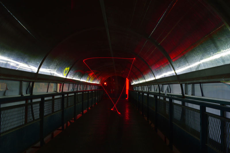 View of illuminated walkway in subway