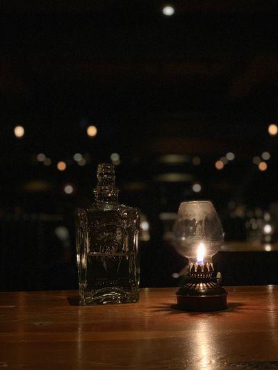 Close-Up Of Illuminated Lamp On Bar Counter