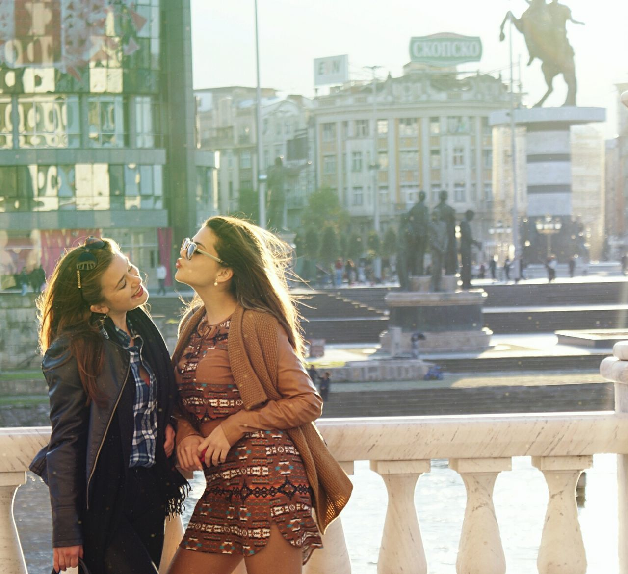 city, building exterior, architecture, built structure, young adult, young women, two people, city life, outdoors, smiling, real people, happiness, women, lifestyles, togetherness, friendship, day, adult, people, adults only