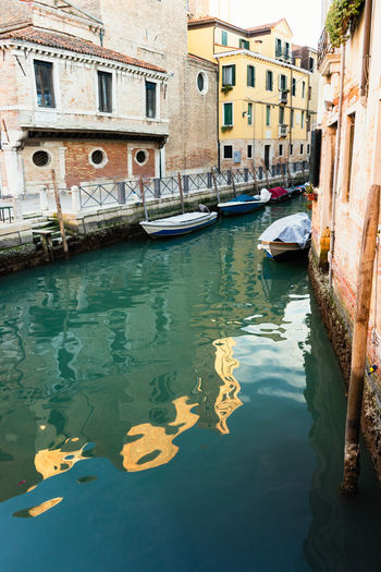 Canal in Venice, Italy Water Nautical Vessel Mode Of Transportation Transportation Building Exterior Architecture Built Structure Canal Reflection Waterfront Day Building Nature Moored City Residential District Travel Outdoors Gondola - Traditional Boat No People Anchored Venice, Italy