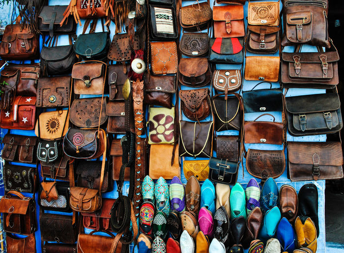 Bags And Shoes Hanging At Market For Sale
