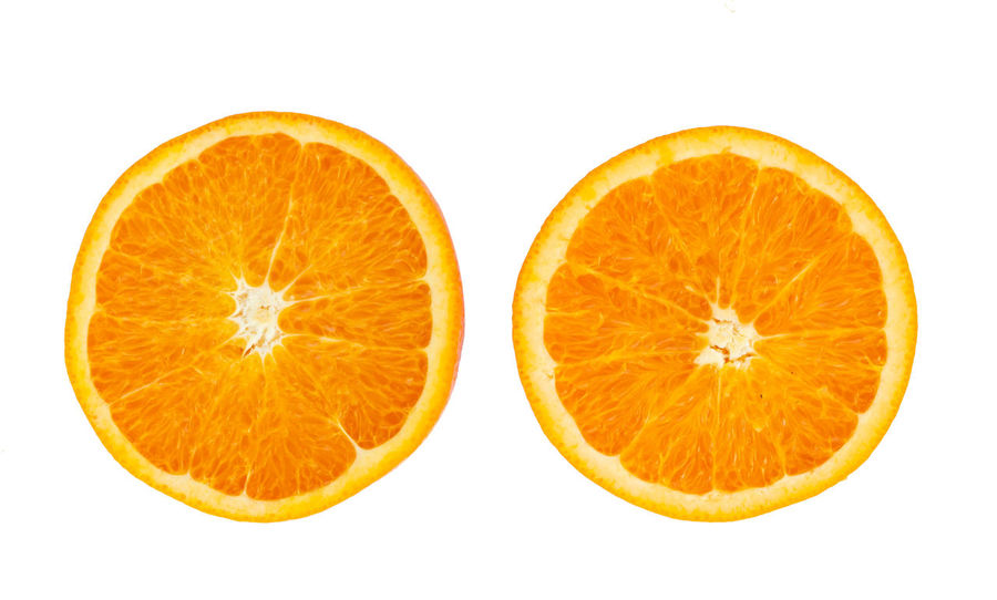 Fresh orange fruit slice isolated on white background Agriculture; Food; Freshness Background; Citrus; Closeup; Delicious; Freshness; Fruit; Half; Health; Isolated; Juicy; Macro; Orange; Organic; Slice; Sweet; Texture; Vitamin; White; Yellow;