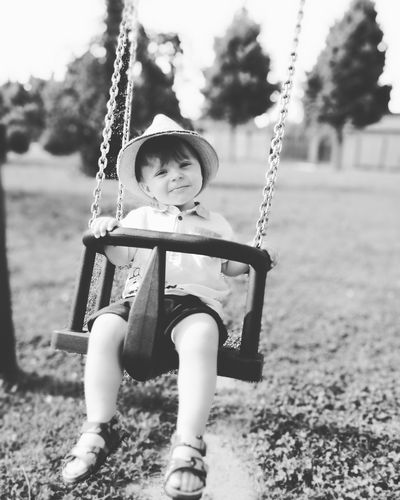 Edo Mylife Childhood Swing Playground Child Children Only One Person Park - Man Made Space Rope Swing Outdoor Play Equipment Playing Smiling Full Length Happiness Fun People Cheerful Sitting Outdoors Day Natural Parkland