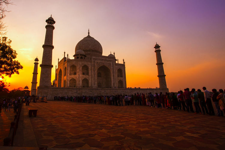 Tourists At Taj Mahal During Sunset