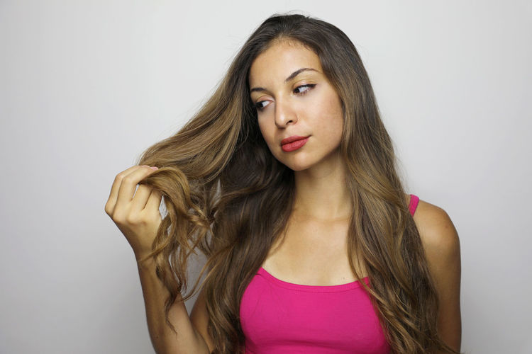 Young woman against gray background