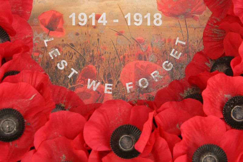 Lest We Forget - 1914-1918 To commemorate the centenary of the First World War years (1914-1918), we created a Travel Notes Calendar to remember the fallen; those who served in the military campaigns fighting for our freedom. This photo was used on the cover. Lest We Forget was originally penned in the poem 'Recessional', by Rudyard Kipling; actually dedicated to Queen Victoria's Diamond Jubilee in 1897; asking God to spare the British Empire, 'lest we forget' (the sacrifice of Christ). The phrase passed into common usage across the British Commonwealth, after World War I; becoming linked with Remembrance Day, as a plea not to forget past sacrifices. 'Lest We Forget' is often found on war memorials, or used as an epitaph. http://pics.travelnotes.org/ 1914-1918 Belgium Flanders Flanders Fields For The Fallen Lest We Forget Michel Guntern Travel Photography Ypres Calendar Close-up Cover Fields Flanders Poppy No People Poppies  Poppies Field Poppies In Corn Poppy Field Red Reef Remembrance Remembrance Sunday Travel Pics World War One