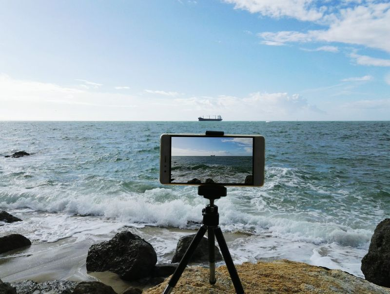 Photography Themes Camera - Photographic Equipment Photographing Technology No People Beach Sea Tripod Sky Filming Horizontal Day Home Video Camera Coin-operated Binoculars Outdoors capturing motion TakeoverContrast Beauty In Nature Scenics Portinho Da Arrábida Setúbal Portugal