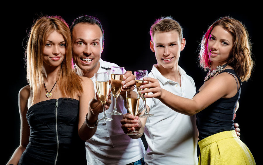 Cheerful group of young people with glasses of sparkling champagne over black background 20 Years Old Beautiful People Champagne Friends Party Time Positive Well-dressed Alcohol Birthday Caucasian Celebration Event Cheerful Cheering Congratulating Couple - Relationship Drink Expression Festive Fizz Group Of People Man And Woman Party Smiling Togetherness Young People