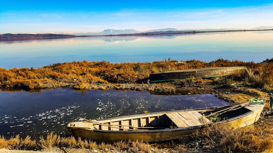 Water Lake Tranquility Nature Sky Business Finance And Industry Blue Outdoors Day Beach Landscape Scenics No People Mountain Horizon Over Water Clear Sky Salt - Mineral Salt Basin Beauty In Nature