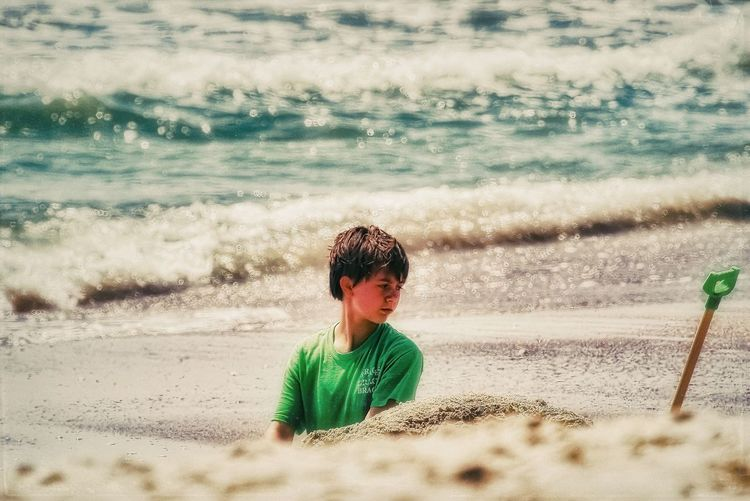 The littoral archaeologist hard at work. 🌞🌊 Pulguita Sand Beach Sea One Person Childhood Water Nature Vacations Outdoors Summer Motion Wave Child Beauty In Nature Sky Ocean Taking Photos The Week On EyeEm Idyllic Memories Having Fun Textures And Surfaces Animals In The Wild