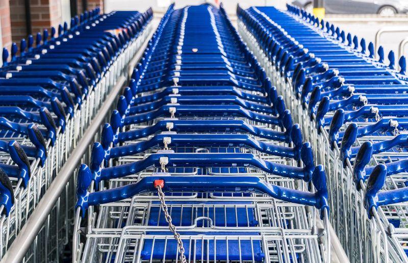 Blue shopping cart arranged in row