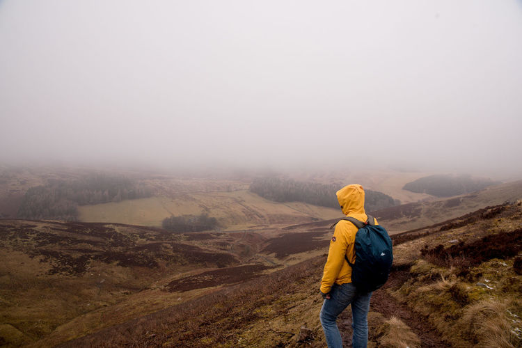 Beauty In Nature Environment Fog Hiking Holiday Landscape Leisure Activity Looking At View Mountain Mountain Range Nature Non-urban Scene One Person Outdoors Rear View Scenics - Nature Sky Tranquility Travel Trip Vacations