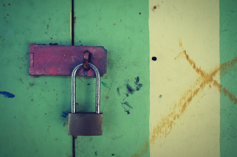 Close-Up Of Padlock Attached To Old Door
