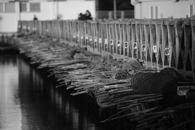 Close-up of pier over river