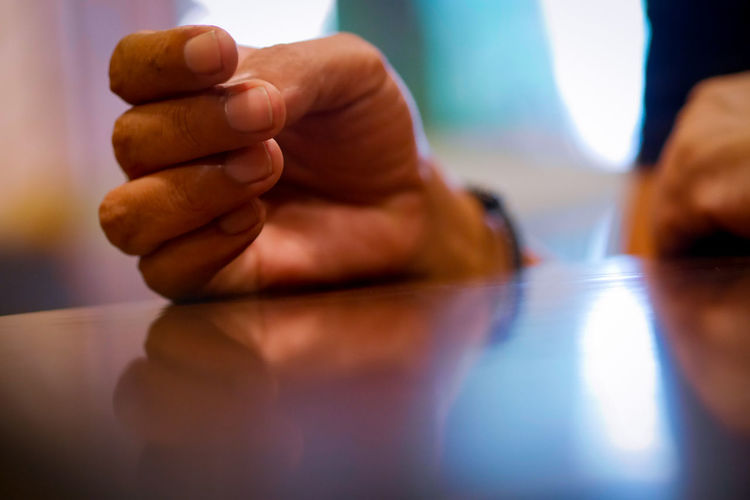 Cropped hands of man at table