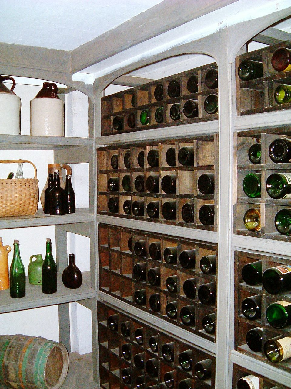 bottle, wine, wine bottle, shelf, indoors, wine cellar, wine rack, alcohol, in a row, large group of objects, winery, storage compartment, drink, variation, no people, arrangement, old-fashioned, cellar, winemaking, day, home showcase interior, close-up