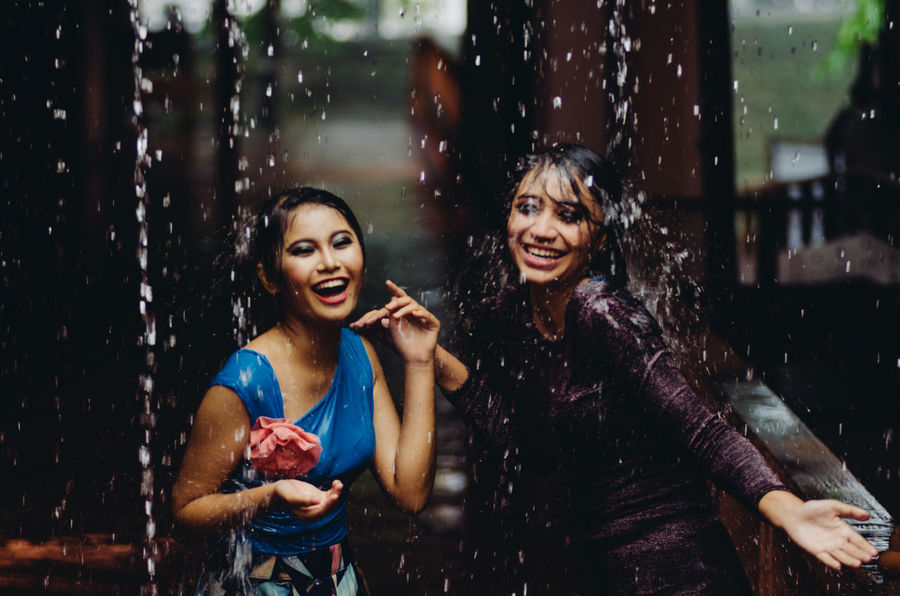 Casual Clothing Confidence  Friendship Front View Fun Happiness Leisure Activity Lifestyles Person Rain Raining Real People Sitting Standing THESE Are My Friends Three Quarter Length Waist Up Wet Women Young Adult Young Women