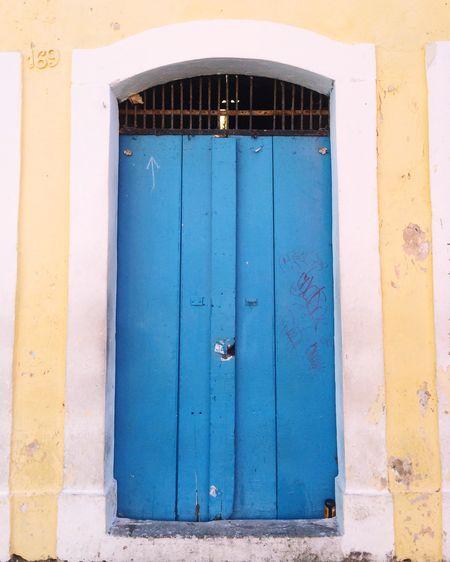 Closed Old Blue Wooden Door Of Building