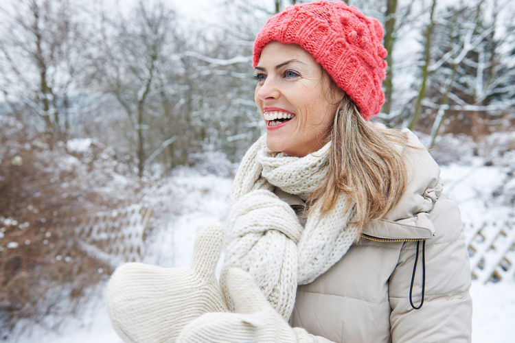 portrait of smiling young woman in snow Active Beautiful Woman Cap Cheerfulness Clothing Cold Temperature Emotion Focus On Foreground Fun Gloves Hair Happiness Happy Hat Holiday Laughing Leisure Leisure Activity Lifestyle Lifestyles Looking One Person Outdoors Outside People Portrait Scarf Ski Holiday Ski Trip Smile Smiling Snow Warm Clothing Winter Winter Clothing Winter Holiday Woman Women Young Adult Young Women