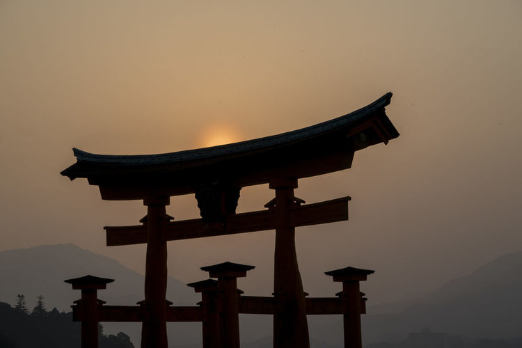 Architecture Beauty In Nature Belief Built Structure Dusk Mountain Nature No People Orange Color Outdoors Place Of Worship Religion Silhouette Sky Spirituality Sunset Travel Travel Destinations