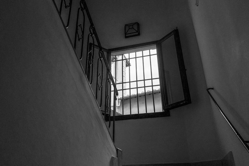 The window Light And Shadow Monochrome Architecture Built Structure Indoors  Window Building Wall - Building Feature Staircase Low Angle View Safety Steps And Staircases Ceiling Sunlight Day