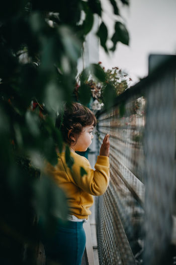 Little girl looking from balcony