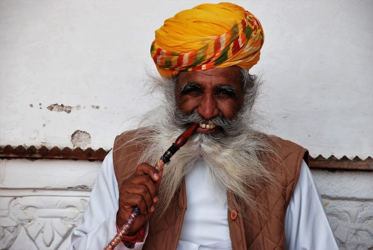 Midsection Of Man Smoking Pipe