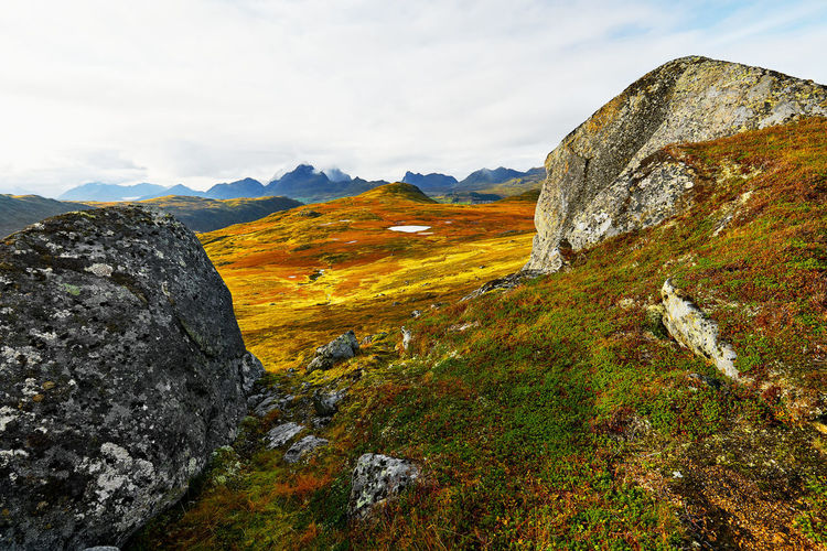 Mountain Beauty In Nature Tranquility Scenics - Nature Tranquil Scene Sky Rock Mountain Range Nature Idyllic Landscape Rock Formation Outdoors Remote Formation Mountain Peak Environment Rock - Object Cloud - Sky Norway Lofoten Wide Open Spaces Scandinavia Grass Vestvågøy