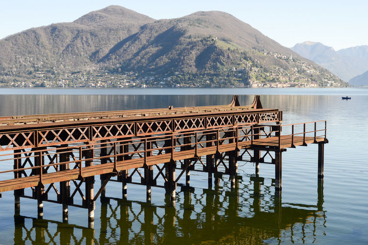 Lake Lake Ceresio Lugano Lake Water Mountain Beauty In Nature Scenics - Nature Mountain Range Nature Day Tranquility Tranquil Scene No People Sky Non-urban Scene Architecture Reflection Waterfront Outdoors Built Structure