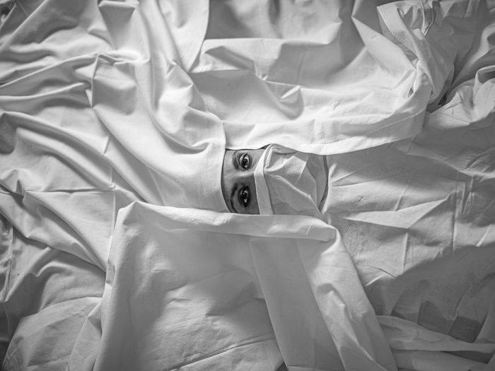 Portrait of woman with sheet