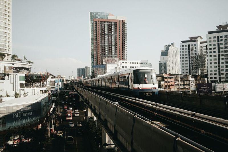Urban Train Against City Building Against Sky
