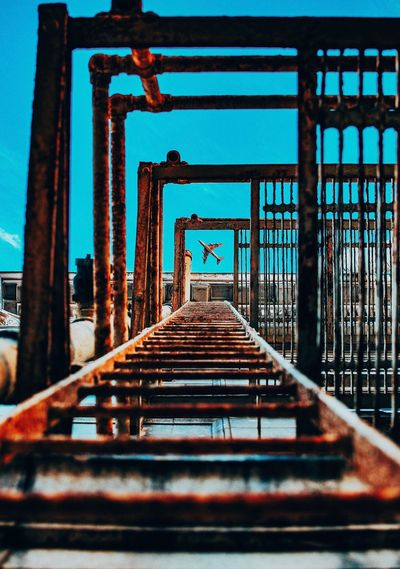 My rides here. Visit whatuprell.com Railing Architecture Built Structure Bridge - Man Made Structure No People Day Indoors  Footbridge Sky Girder Plane Urbex Downtown Ladder Lookingup Edit Manipulation Wichita Creativity Explore