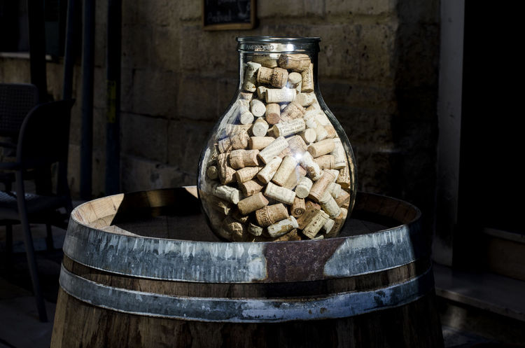 Many cork caps in a huge jar placed on a cask as a decoration in front of a restaurant in Lecce, Italy BIG Caps Cat Close-up Cork Decoration Filled Huge Jar Lecce Lecce - Italia Lecce City Lots Many Restaurant Taking Photos Tradition Tun Mahathir Wine
