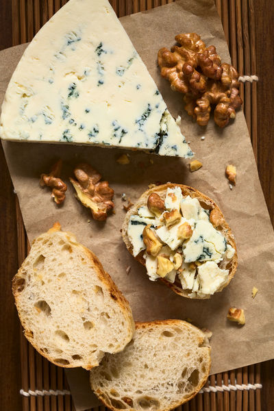 Blue cheese and walnut canape, photographed overhead with natural light (Selective Focus, Focus on the top of the canape and the blue cheese slice) Baguette Blue Cheese Breakfast Canapé Nuts Sandwich Blue Mold Blue Mold Cheese Bread Brunch Cheese Dairy Dairy Product Flavor Food Food And Drink French French Food Meal Nut Piece SLICE Snack Walnut White Bread