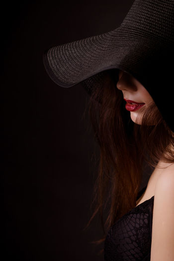 Elegant woman wearing hat