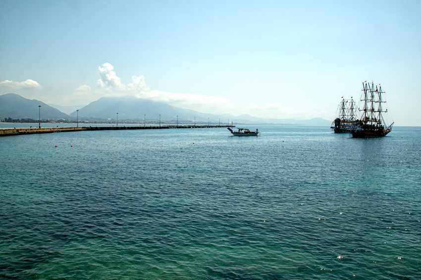Pirate Ships Alanya Mediterranean  Mediterranean Sea Turkey Beauty In Nature Clear Water Cloud - Sky Emeraldcoast Emeraldgreen Mode Of Transportation Mountain Nature Nautical Vessel Pirate Ship Sailboat Scenics - Nature Sea Ship Sky Tourquise Sea Tranquil Scene Tranquility Transportation Water Waterfront
