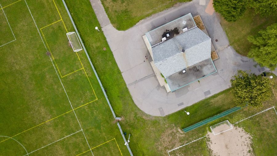 Aerial view of built structure by soccer field