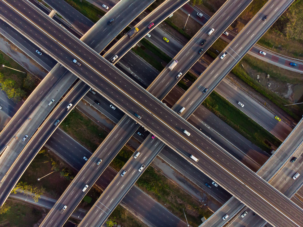 no people, high angle view, architecture, transportation, day, road, outdoors, built structure, glass - material, pattern, full frame, city, connection, street, transparent, land vehicle, nature, metal, mode of transportation, building exterior, multiple lane highway