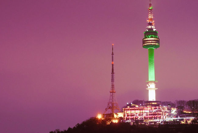 Namsan Seoul tower at night, Korea in March 2018 City Cityscape Green Color Late Afternoon Low Light Namsan Tower  Seoul Skyline South Korea Tourist Attraction  Urban Scene View Beam Building Exterior Destination Downtown District Famous Place Landmark Metropolis Mountain Night Pink Color Purple Sky Travel Destinations