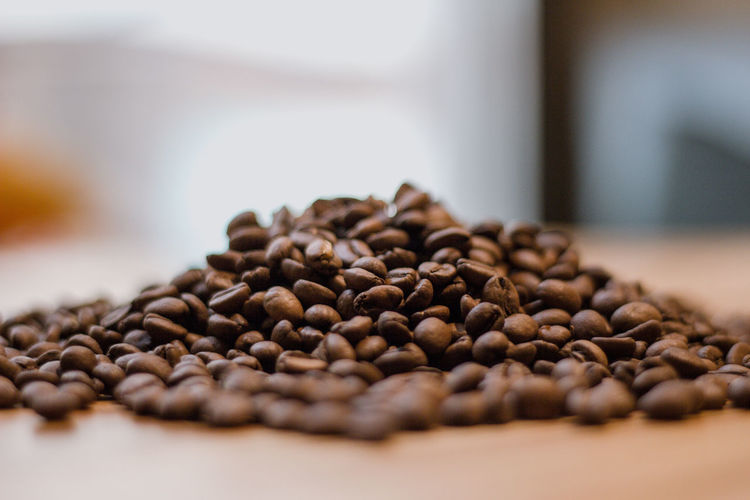 Food And Drink Food Selective Focus Roasted Coffee Bean Indoors  Large Group Of Objects Coffee Brown Coffee - Drink Freshness Still Life Table Abundance Close-up Roasted No People Copy Space Caffeine Focus On Foreground Raw Food
