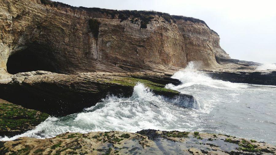 Waves splashing on rock formation