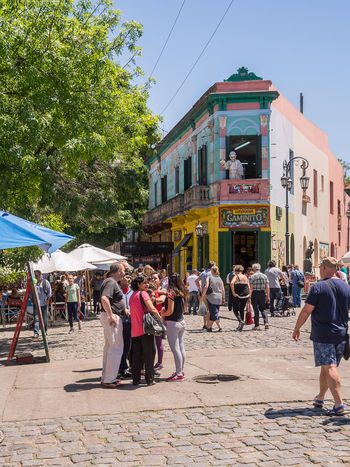 Buenos Aires, Argentina - November 5, 2016: Tourist and market in strreet of Caminito in District Boca of Buenos Aires Argentina Boca Buenos Aires Caminito Capital City Color District House La Boca Landmark Painted Toursits Urban