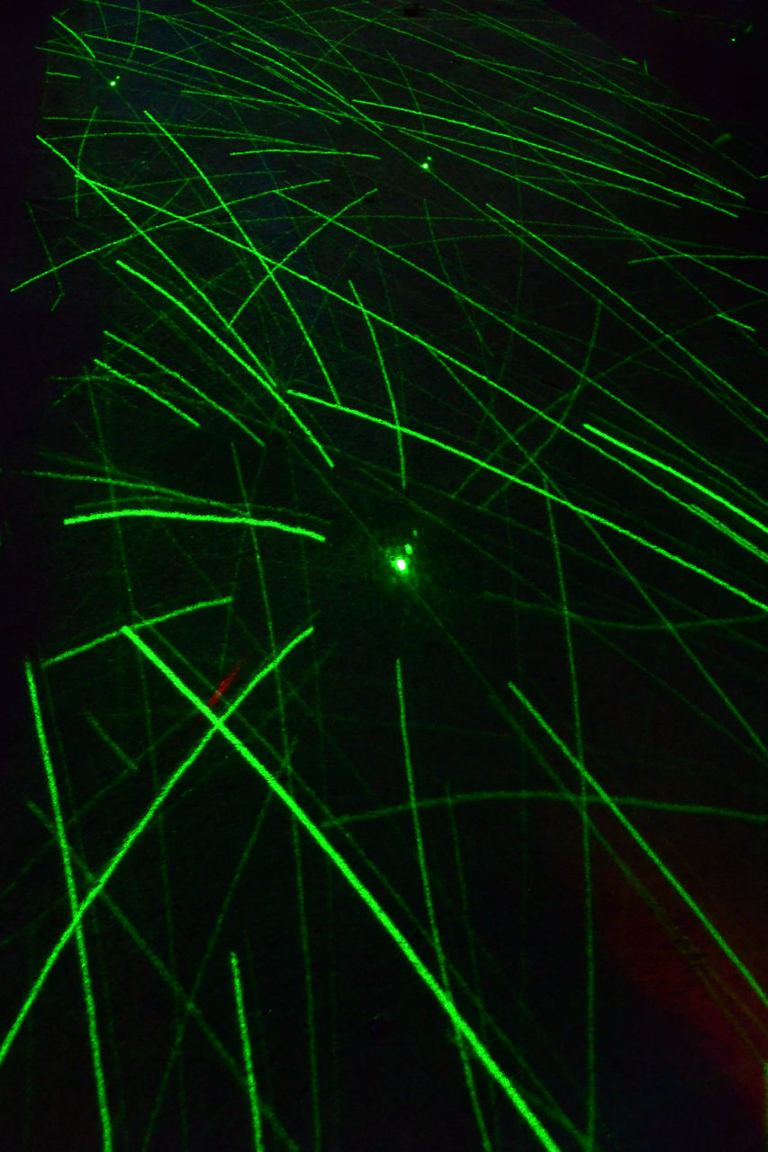 night, green color, illuminated, laser, no people, outdoors, black background, nature, close-up