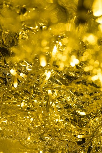 Gold Colored Illuminated Gold Shiny Glowing Wealth Backgrounds Full Frame Celebration Christmas Crystal No People Luxury Yellow Christmas Decoration Indoors  Close-up Low Angle View Golden