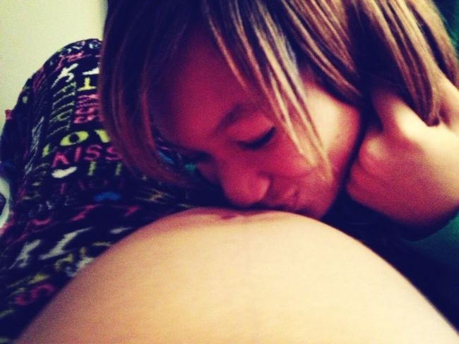 My sister kissing my belly