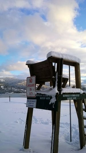 Cloud - Sky Text Sky Water Road Sign Outdoors Extreme Weather No People Day Cold Temperature Winter Sandpoint Idaho