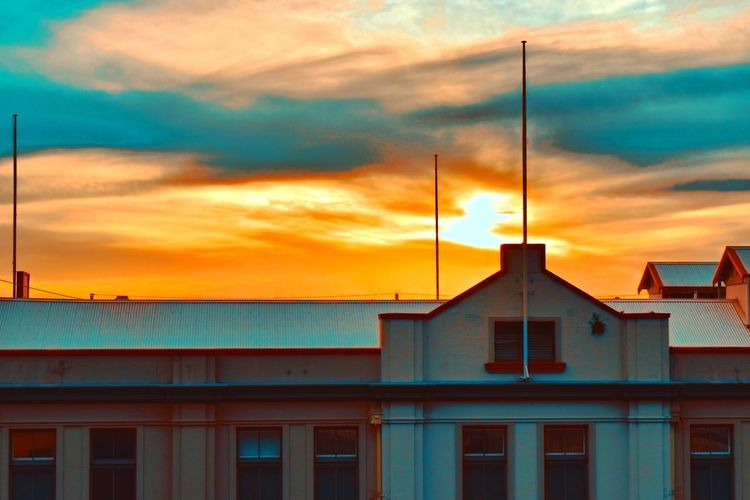 Historic sunset EyeEm Selects Sun Outdoors Photooftheday Picoftheday EyeEm EyeEm Gallery Photography Colours Views Architecture Cloud - Sky Architecture Built Structure Building Exterior Sky Sunset Building No People Orange Color House Nature City Residential District Outdoors Window Dusk Dramatic Sky Street Water